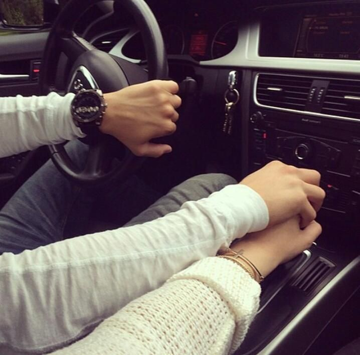 couple hands in car