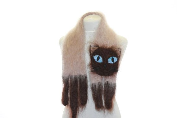 Each cat scarf has a hand sewn face to reflect its personality, and knitted tail and paws. Description from pawesomecats.com. I searched for this on bing.com/images