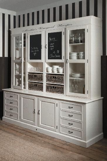 large hutch - maybe make from a dresser or two and but a couple cupboards/shelving units on top?!
