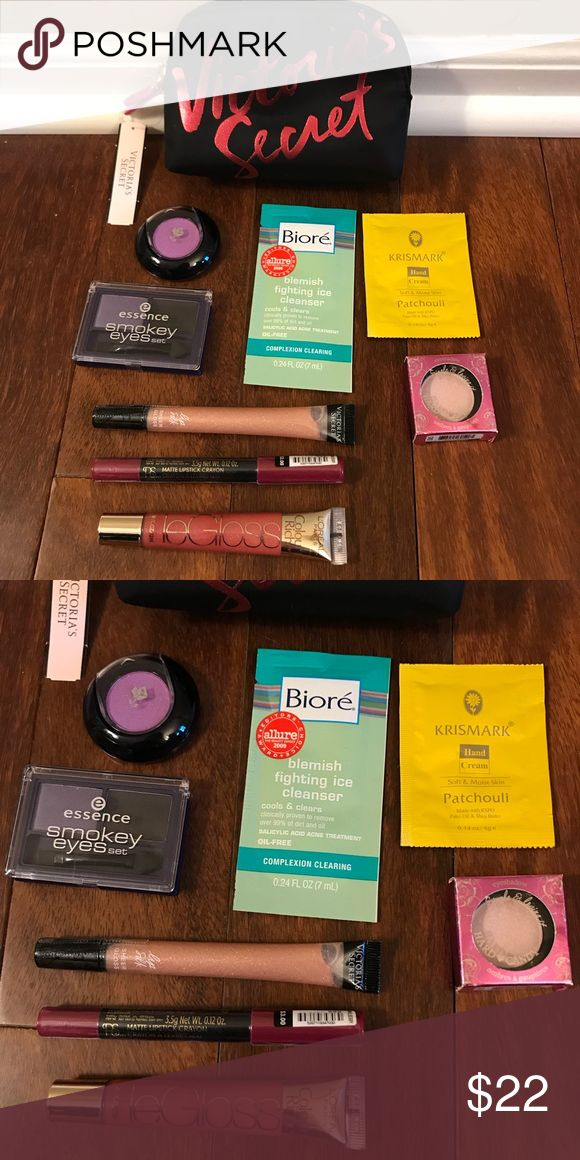Victoria's Secret mini pouch filled with cosmetics Victoria's Secret mini pouch filled with cosmetics. Includes essences Smokey eye set in purple maniac, hard candy eye shadow in flirty, Lancôme eye shadow purchased at sample sale (no color name), LOreal Le Gloss color saucy mauve, primark matte lipstick crayon in mulberry, Victoria's Secret lip silk sheer gloss in sparkling, biore ice cleanser sample, and Krismark hand cream. Victoria's Secret Makeup