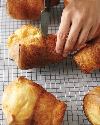 How do you transform a basic egg batter into tall, tender, airy pockets surrounded by a burnished crust? It's not magic but kitchen physics, sparked by the combination of a preheated pan and a hot oven. Popovers, the American version of Yorkshire pudding, are quick and easy to make; they add a sense of fun to any meal, from a holiday brunch to a simple supper.