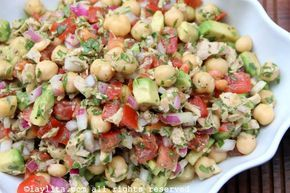 Simple and delicious chickpea salad with avocado and tuna fish, these quick and refreshing salad is made with garbanzo beans or chickpeas, avocado, tuna fish, red onions, tomato, lemon, mustard, olive oil, and cilantro.