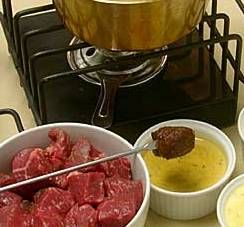 Beef Fondue Recipes - 3/4 cup soy sauce  1/4 cup Worcestershire sauce  2 garlic cloves, minced  5 pounds beef tenderloin, cut into 1-inch cubes