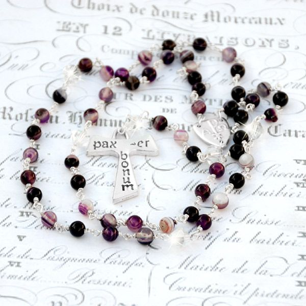 Agate Gemstone Tau Rosary - Crafted with Aves (Hail Mary beads) of 6mm purple banded agate gemstone and Paters (Our Father beads) of 8mm Sparkling Swarovski crystal bicones. The Tau cross is pewter (lead & nickel free) and measures 4cm by 2.75cm. The center medal (1.5cm by 1.5cm) is a triangular pewter Chi Rho.
