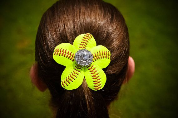 Made from a real ball, these flowers for her hair will make her the talk of the bleachers.  Designed to clip into the hair just above or over a