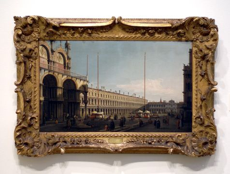 """""""The Piazza San Marco, Venice, looking towards the Procuratie Nuove and the Church of San Geminiano from the Campo di San Basso,"""" by Giovanni Antonio Canal, il Canaletto, oil on canvas, 18 5/8 by 30 inches"""