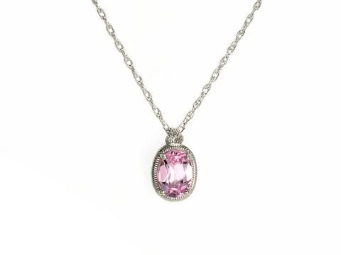 "Silver Created Pink Sapphire & Diamond Pendant with Chain  From our birthstone collection; created pink sapphire is the gemstones for October.  Sterling silver lab created pink sapphire and diamond pendant with chain  Chain length: 18""  Weight: 1.4 grams  Pendant size: 6.7mm wide x 11.2mm long  Check out our necklaces here: https://hwilliamsjewelleryshop.com/collections/all-products/products/silver-created-pink-sapphire-diamond-pendant-with-chain"