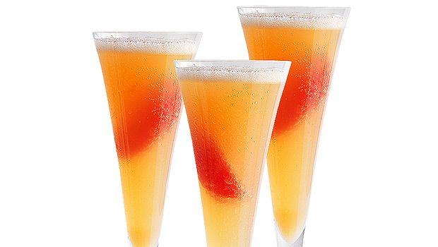 Grapefruit Bellini...grapefruit juice, frozen peaches, Prosecco, red grapefruit..