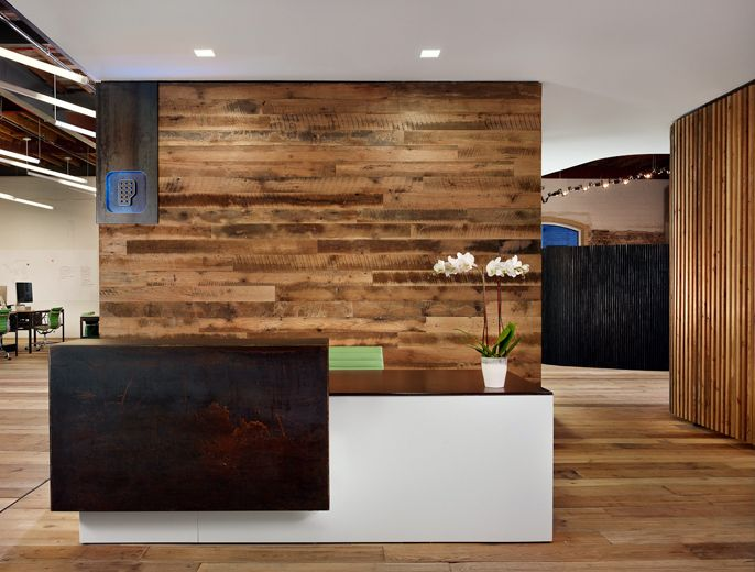 Reception desk. Floating reception desk amid open office layout - Peddle Office [Alterstudio and One Eleven Design]