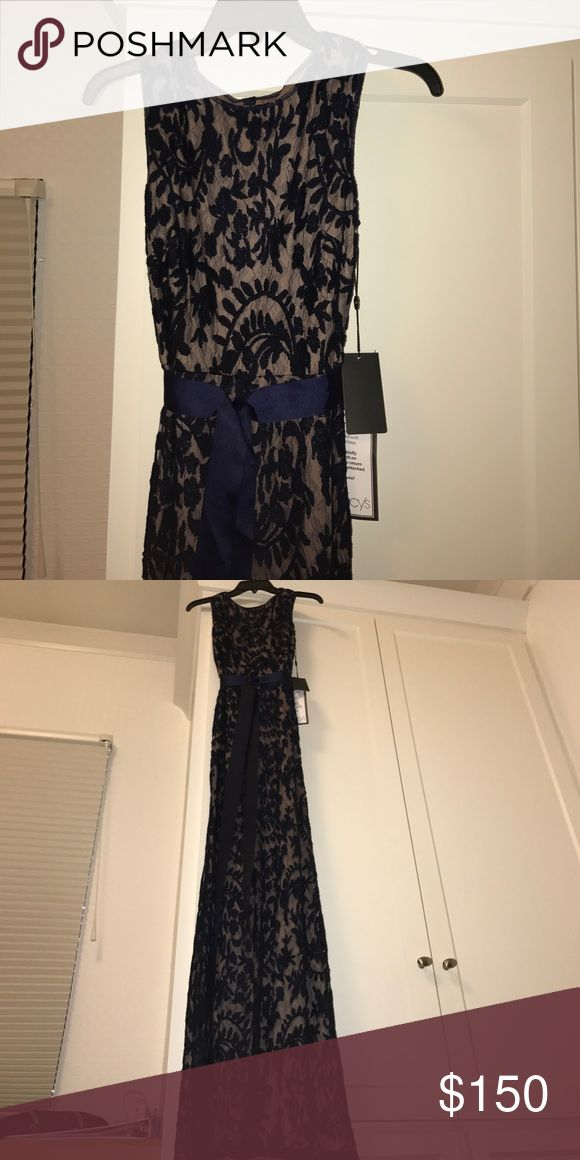navy blue lace and nude formal dress This lovely, new (never worn) gown is a nude base with navy blue lacing over it. To top it off there is a navy blue tie Macy's Dresses Maxi