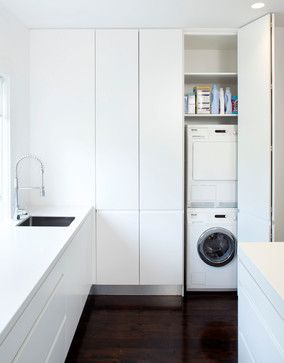 Beautiful, simple yet stylish white laundry room. Like this a lot!