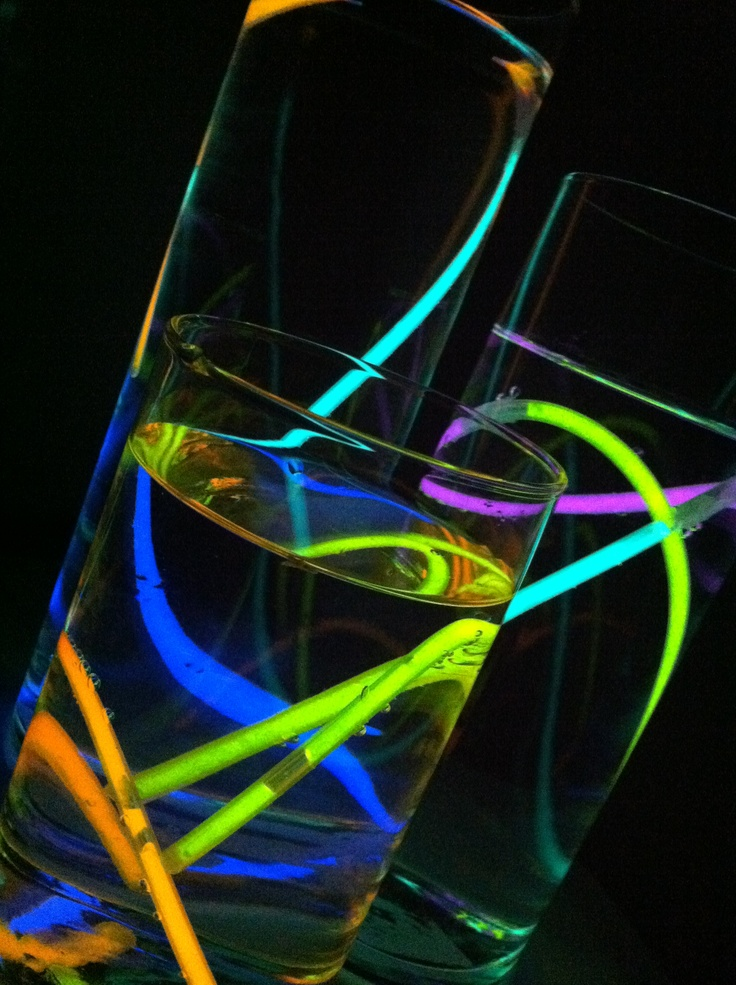 Centerpieces For My Brother S Tron Party Glow Sticks In Water Futuristic Party Graduation Party Centerpieces Glow Party