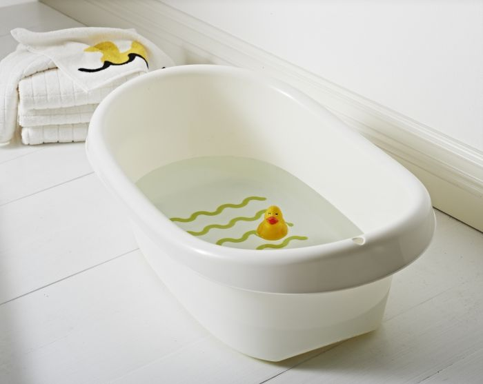 """LÄTTSAM baby bath has an anti-slip bottom and slide protectors to hold it steady. """"The baby bath has round, gentle shapes that encircle the baby.  And it's formed to make it easy for you to fill and empty the bath."""" --  Designer Tina Christensen."""