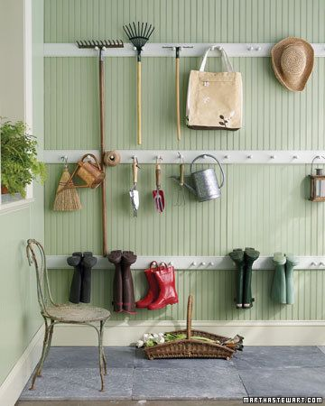 """Love the idea of 2"""" x 1"""" planks of wood with hooks on them."""