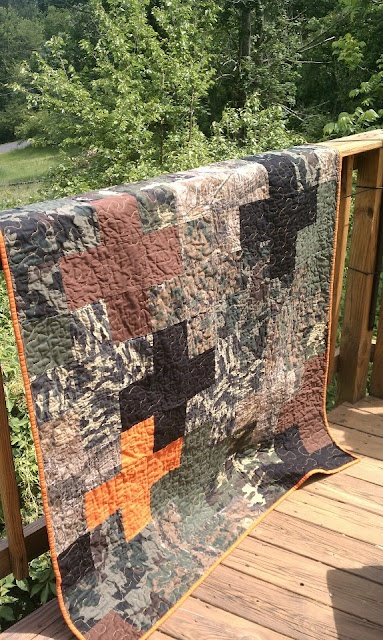 classy camo quilt...I would try this in mixed floral prints.