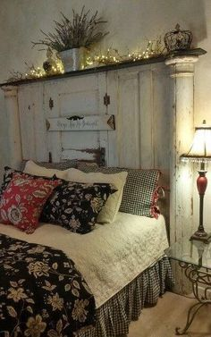 Look at the fabulous architectural salvage piece behind the bed- it's part of an old wall and door. Home Decor