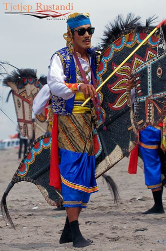 """Kuda Lumping one of the performer.Kuda Lumping also called """"Jaran Kepang"""" is a traditional Javanese dance depicting a group of horsemen. The dance employs a horse made from woven bamboo and decorated with colorful paints and cloth."""