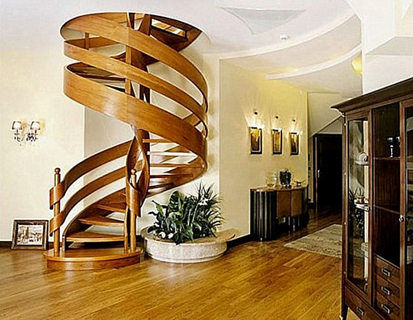 Wooden spiral staircase with ribbon-like railing>  Love these stairs.