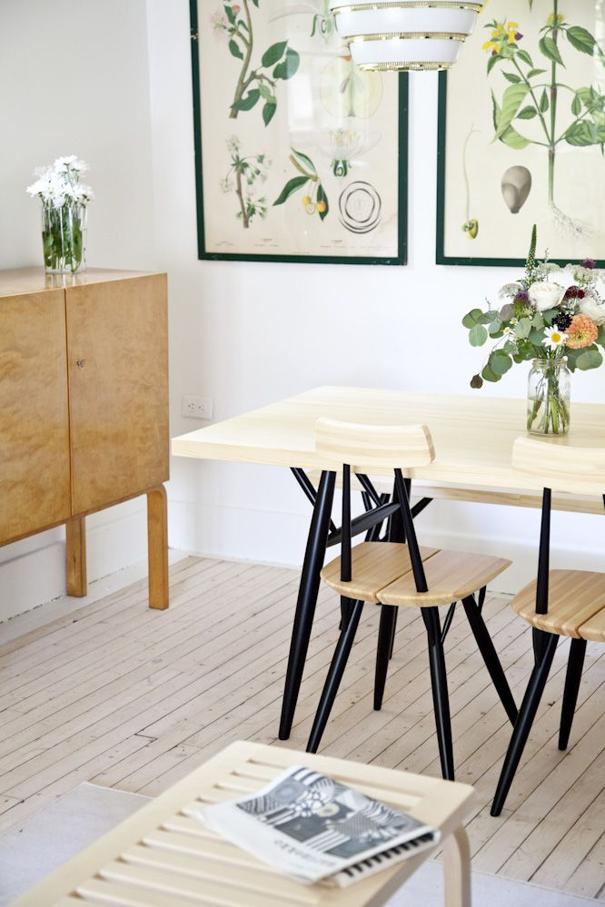 The dining area is anchored by an Ilmari Tapiovaara dining set for Artek designed in 1955 (it's available at Mjolk). On the wall is a trio of framed Swedish lithographs found at Toronto's Junction Flea; the 1940s cocktail cabinet by Alvar Aalto was an online find.