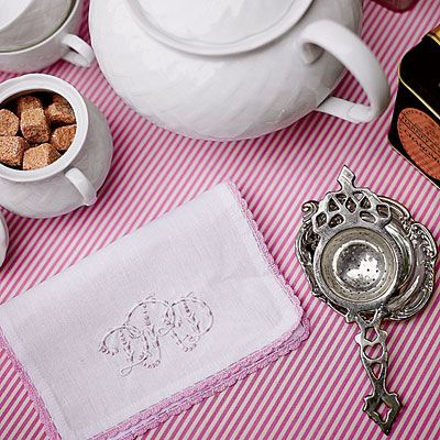 "A Ladylike Tea | Add a Luxe Touch | ""Cloth napkins make your party feel a little more spiffy, and you can use them over and over,"" she says. ""Don't forget pretty details such as monograms or embroidery. I also like to make napkins from inexpensive pink gingham fabric and just leave the edges frayed—no need to sew!"""