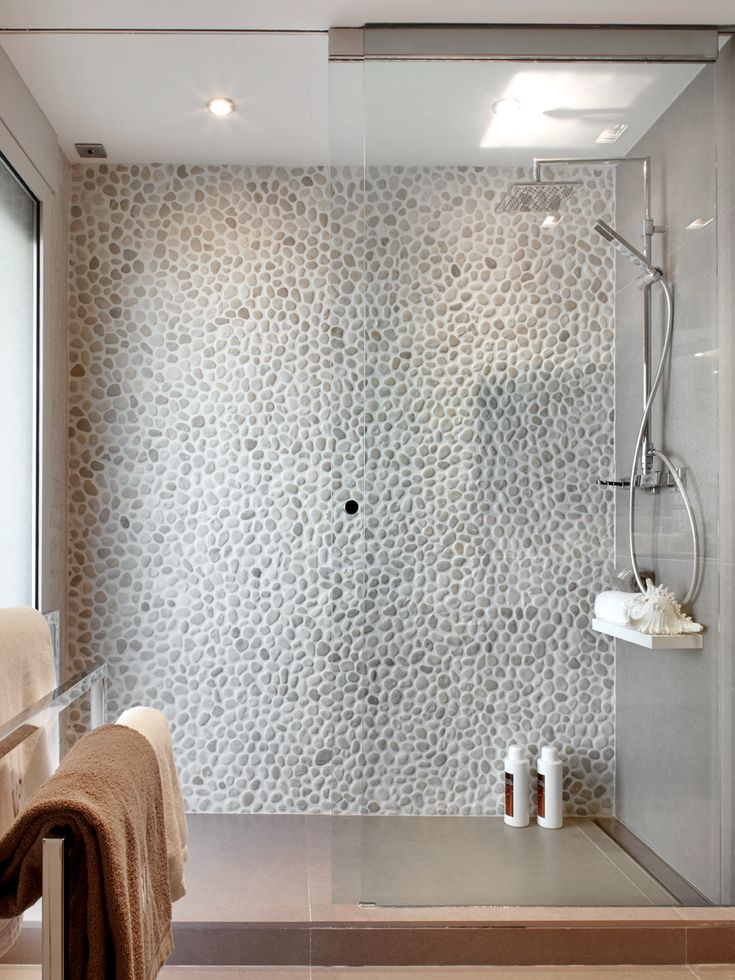 Pebble Wall - a large shower (if you have room) is a wonderful thing. #bathroom #inspiration #Interiors
