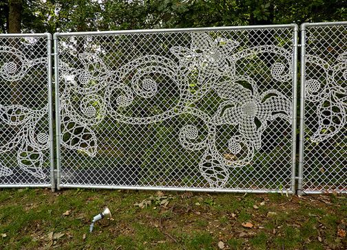 An embroidered wire within industrial fencing chain link fence made to look like lace.  I want this in my back yard instead of the plain old chain link I have.  Available in the US from droog.com but sadly not in Hawai`i :-(