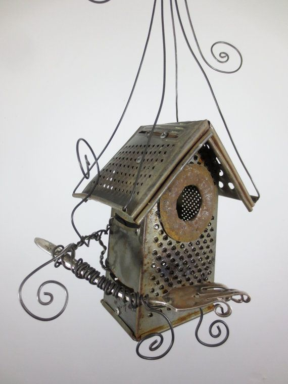 Here is a delightful birdhouse for your garden. These kitchen cast-offs have seen better days. Created from old and rusty cheese graters and a vintage fork. It stands about 17 tall. This will continue to rust if exposed to the rain and snow. If this birdhouse has sold please contact me I would be happy to create something similar for you!    You can see more of my twisted art on my shop's main page:  http://www.etsy.com/shop/thedustyraven    My sculptures are made using as much re-claimed…