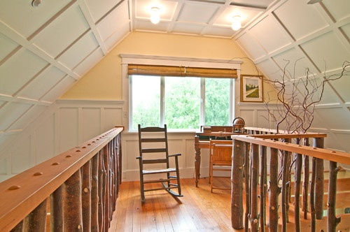 Vashun Island home - In order to place a power line easement alongside the property, the power company had to cut back the limbs of a tree. Demyanovich collected the branches and repurposed them for beautiful banisters in this upstairs space.