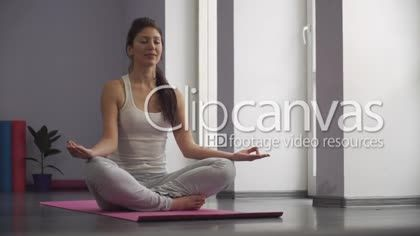 Yoga woman meditating and making a zen symbol with her hand. Soft panorama. HD Stock Footage Clip. Medium shot. 2016-02-01, UKRAINE.