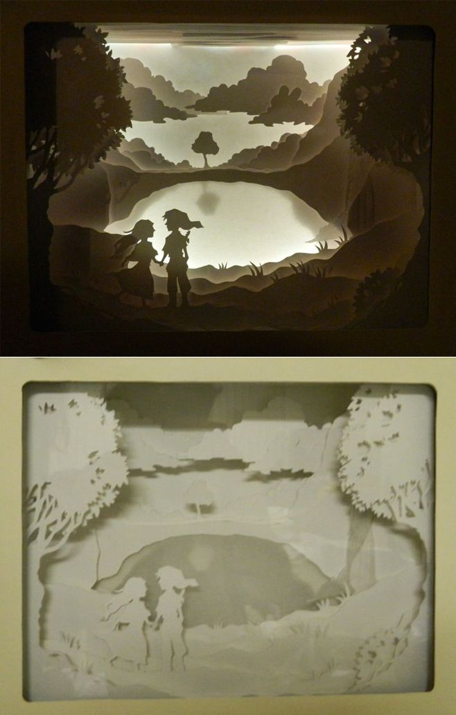 Beautiful Link & Zelda shadowbox papercutting! Instructable at the link.