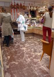 sawdust on floor in the butcher's shop - we used to kick it into little piles while granny was putting her order in