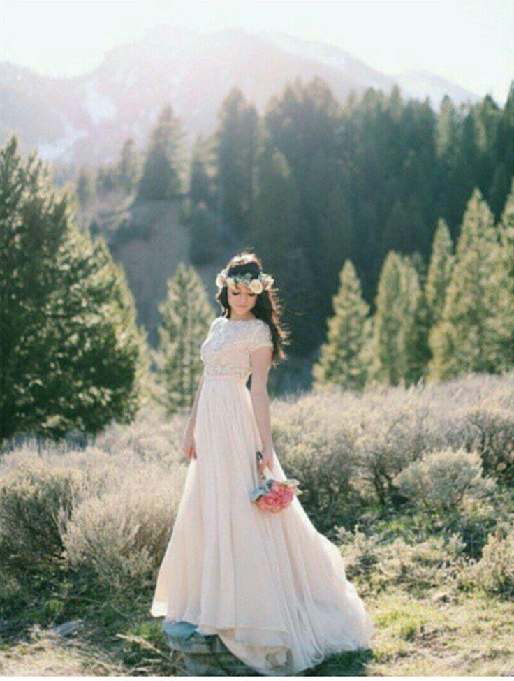 modest wedding dress with beaded bodice and flowy skirt from alta moda.