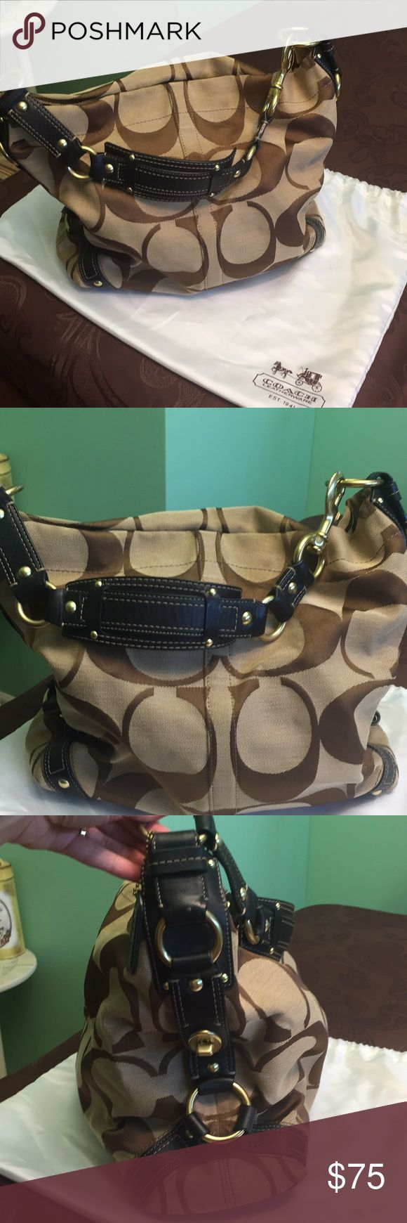 Coach Hobo Bag Beige/brown signature canvas Coach hobo shoulder bag with black leather strap. Comes with Coach dustbag for proper storage:) No stains, just a cleaning up of the brass metal rings and it looks brand new:)) Coach Bags Hobos