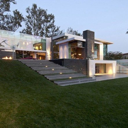 Gorgeous Green Modern Beverly Hills Home With A Bowling Alley That Has An Underground View of The Pool.