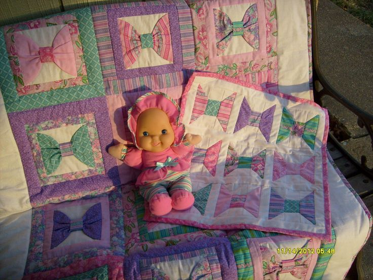 Bow quilt with babydoll and quilt!