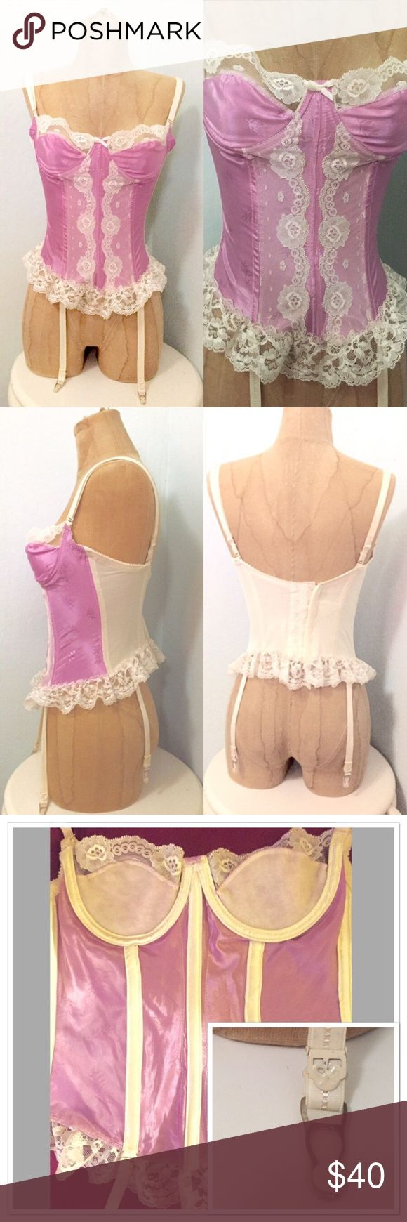 """Vintage Pastel Lavender Corset Unique satin fabric with embroidered detail in material. Cream lace trim, garters attached, 6-hook closure along back, 2 sizes adjustable. Adjustable garter and straps as well. Last pic shows with a flash camera. Color is more pastel in real life.  -Label: Sabrina -Marked Size: 34 -Estimated Size: XS, A-B Cup -Material: Nylon -Condition: Some wear and age, but great shape. -Measurements Are Taken While Flat: -Cup to Cup: 12"""" -Width: 14"""" -Waist: 13""""-14""""…"""