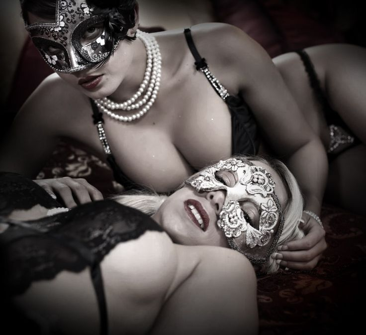 nude women in masks at party