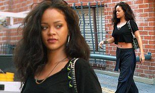The 27-year-old singer was spotted out and about in Beverly Hills, dressed down in baggy trousers and an abs-baring crop top.