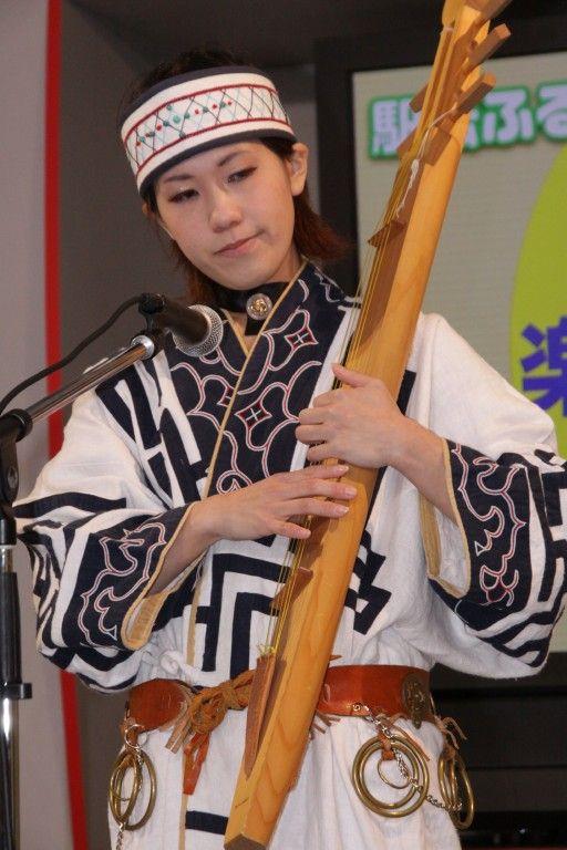 Ainu woman playing tonkori