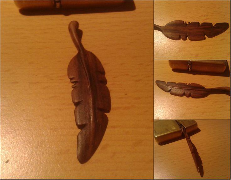Walnut wood, feather pendant. Darkening with coffee.