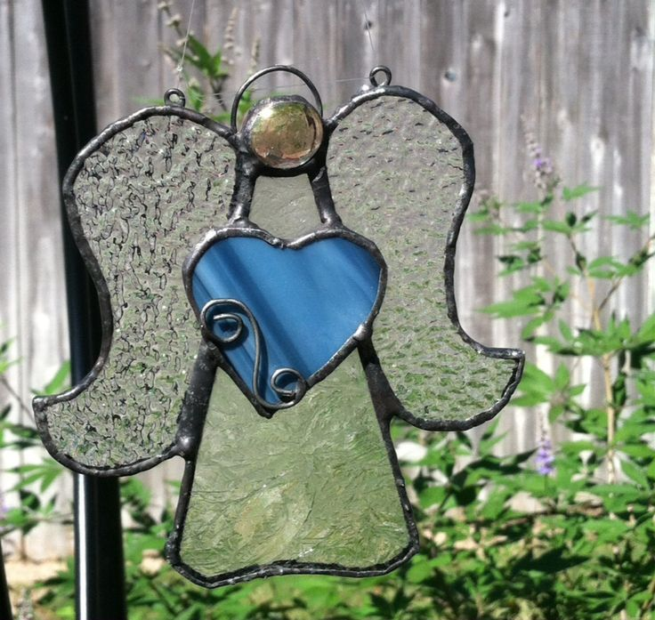 """A stained glass angel abt 5"""" long with black patina"""