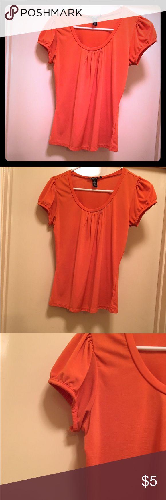 Cute short sleeve orange 🍊 woman top. 🍁 Cute women's short sleeve orange 🍊 top. Excellent condition! Made of 95% polyester 5% spandex. Tops Tees - Short Sleeve
