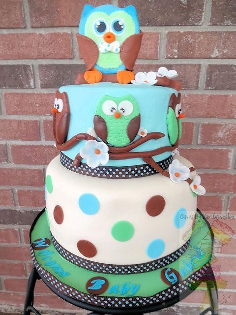 Owl Baby Shower Cake  - Owl theme baby shower cake for boy     Vanilla butter cake filled/frosted with a vanilla buttercream and covered with marshmallow fondant. Fondant and gum paste decorations.     Topper is made out of gum paste.
