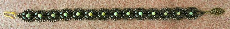 "Linda's Crafty Inspirations: Bracelet of the Day: SuperDuo Rosette Bracelet - Black & Mint-- SUPERDUO ROSETTE BRACELET 11/0 seed beads Toho ""Antiqued Metallic Black"" (TY-11-Y0503) * SuperDuo beads ""Jet Bronze Picasso"" 3mm Druks ""Mint Picasso"" (Nirvana Beads)"