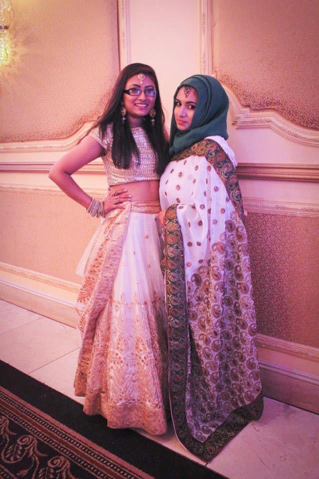 White saree green hijab at a wedding.