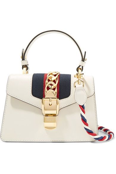 309f1a0ced4a GUCCI Sylvie mini chain-embellished leather shoulder bag.  gucci  bags  shoulder  bags  hand bags  canvas  leather