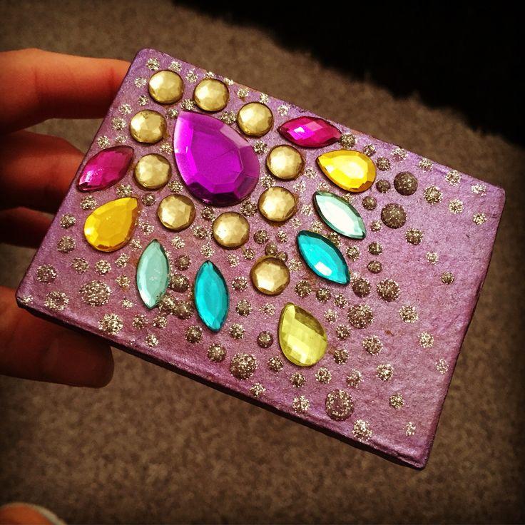 Hand painted cardboard trinket box using gems and glitter glue!