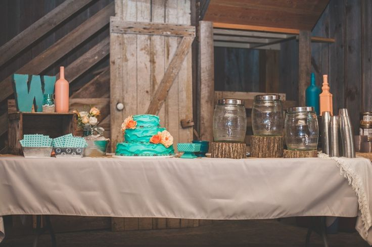 Ashley Taylor's Rustic Farm Wedding Part One, Lawrence, KS Wedding Photographers » Gracenote Photography peach, teal, turquoise, wedding, farm, barn, wedding cake, bottles, mason jars, table, rustic, reception, string lights, burlap, logs