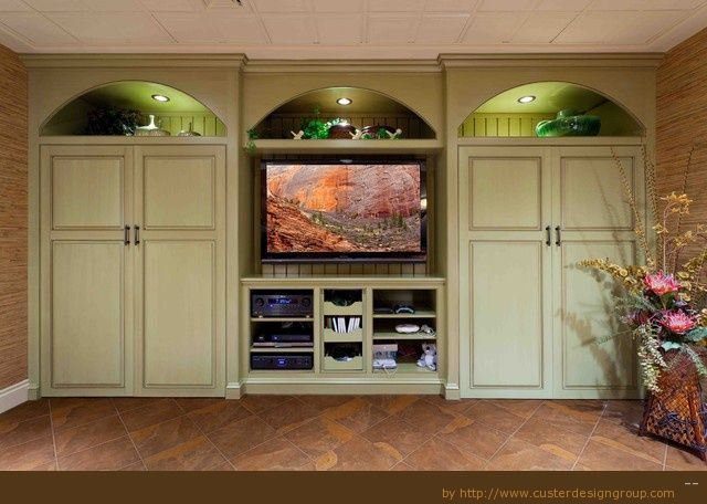 cabinetry for bedroom storage | Traditional family room storage cabinet built in tv wall and lighting ...