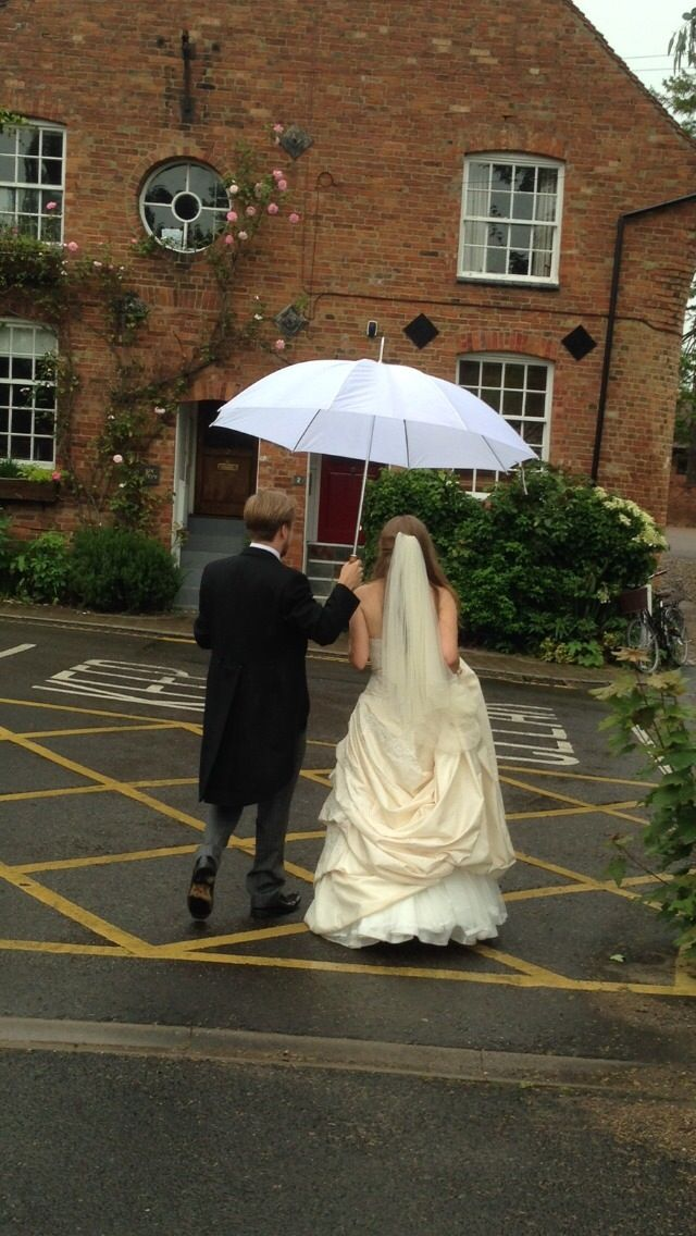 Evidence of why rain is beautiful on a wedding day! I feared it for months but I am so glad it rained now - how cute is that umbrella?